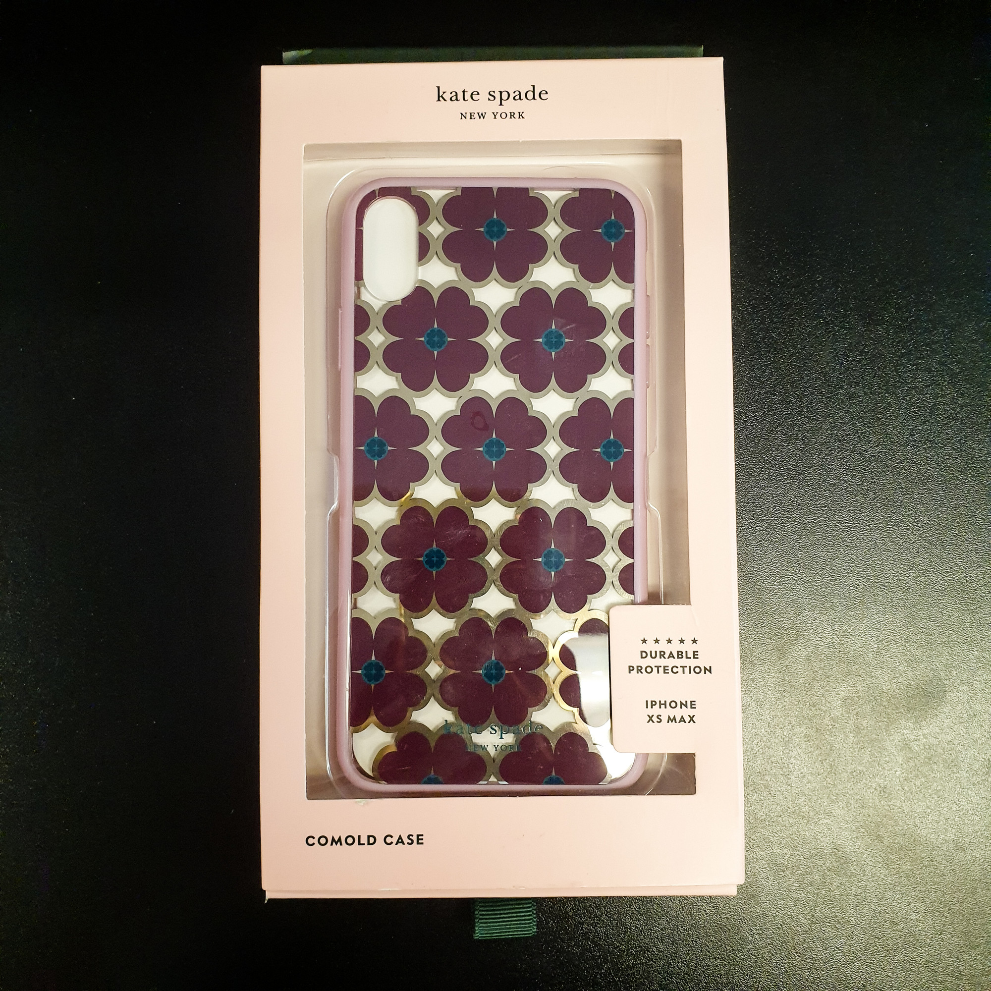Beautiful Kate Spade Phone Case.<br /> - Brand new<br /> - IPhone XS Max<br /> - Lillac, purple and teal color<br /> - Flower design<br /> <br /> * Please note that these measurements and pictures are for reference only and may vary slightly from the original.