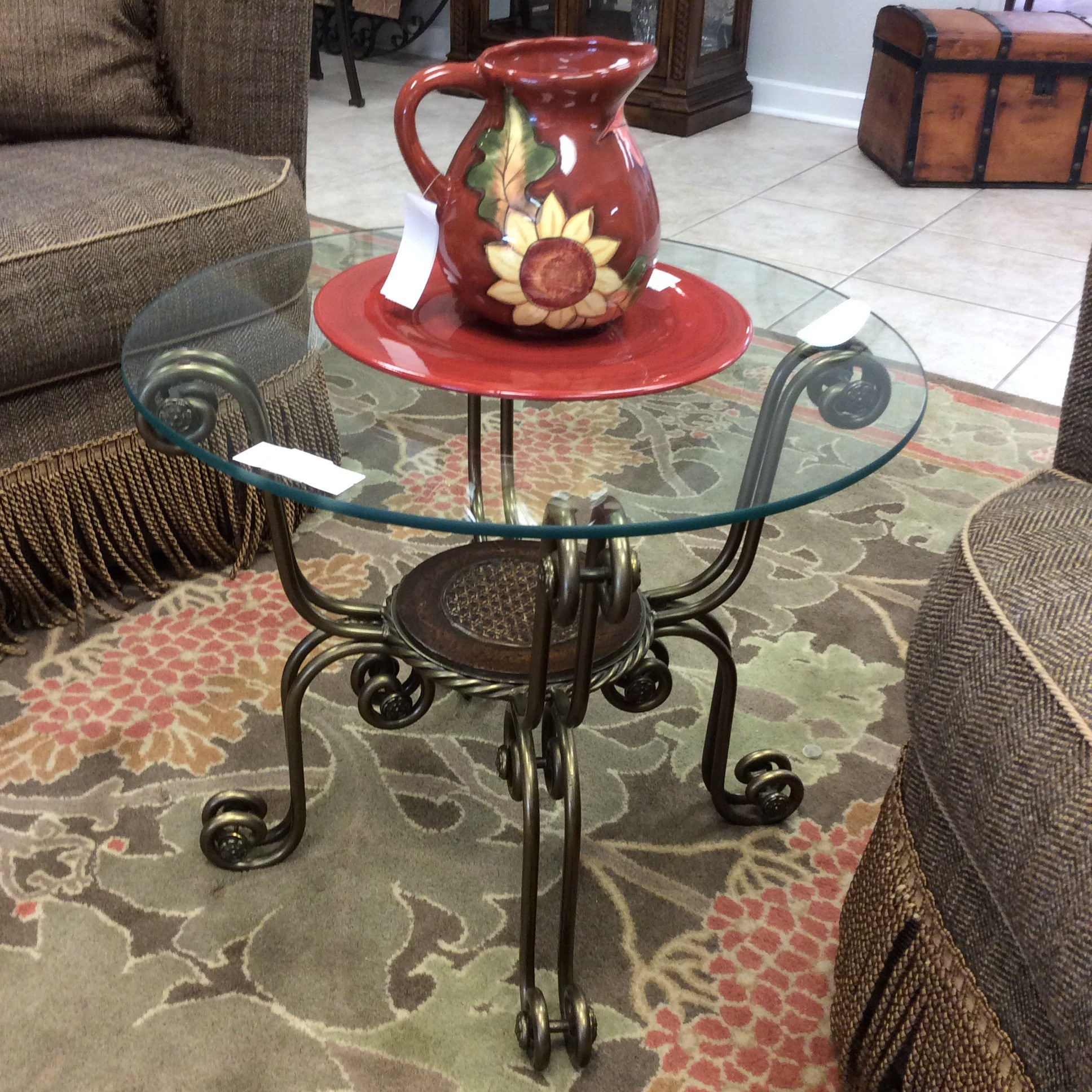 What a lovely combination of brass, glass and wood! On the smaller side, this side table is loaded with personality! The heavy glass top is supported by a base of scrolling burnished brass. The small center at the lower tier holds yet another charming detail - a small cain inlay. Lovely...