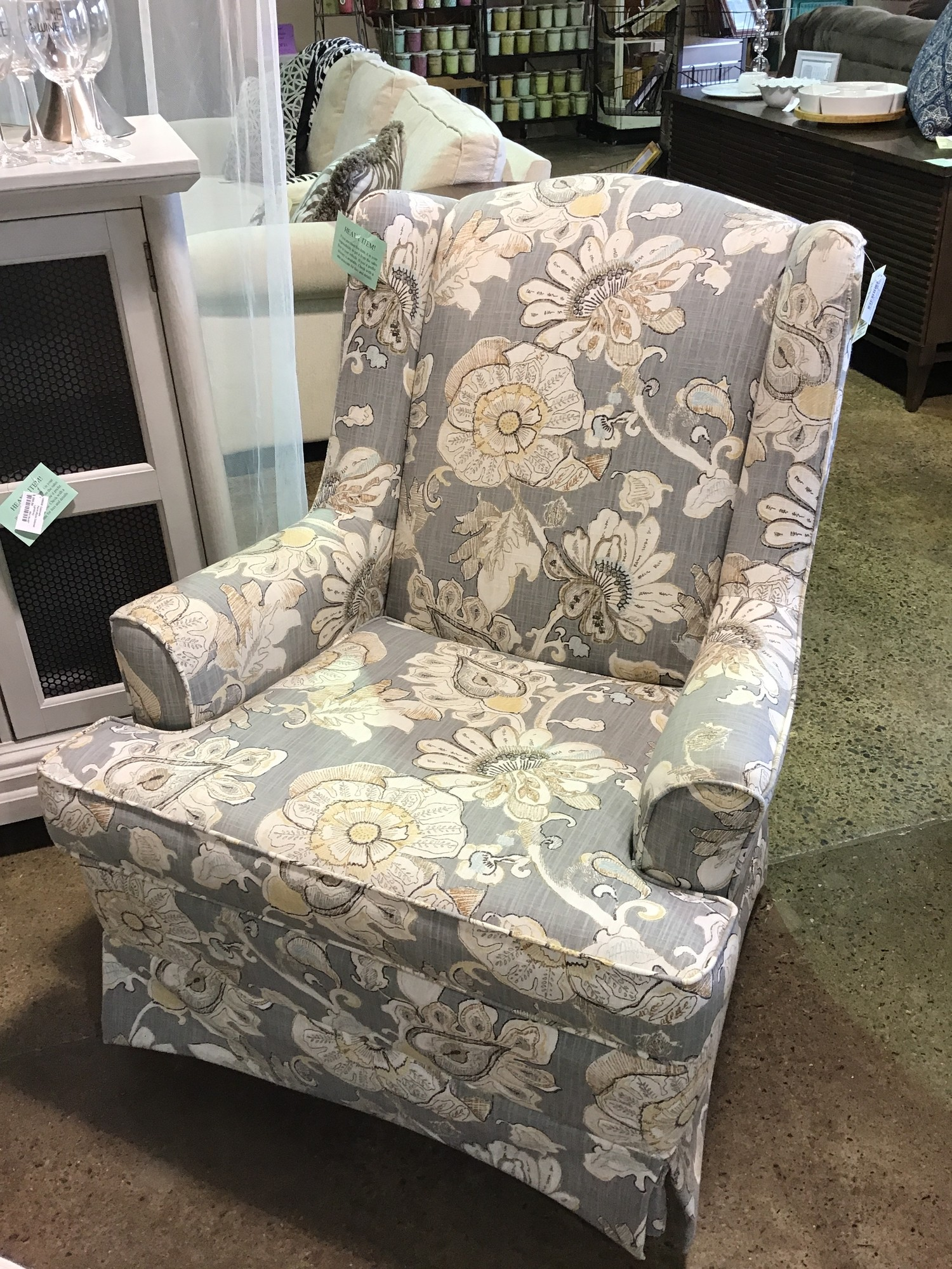 "This beautifully upholstered chair is a swivel rocker (our favorite!) and is very neutral. It has accents of yellow and teal along with the gray & cream fabric. Super comfortable and the bottom cushion is flippable! It was made by Best Chair Inc.<br /> Dimensions are 32"" x 36"" x 40"""