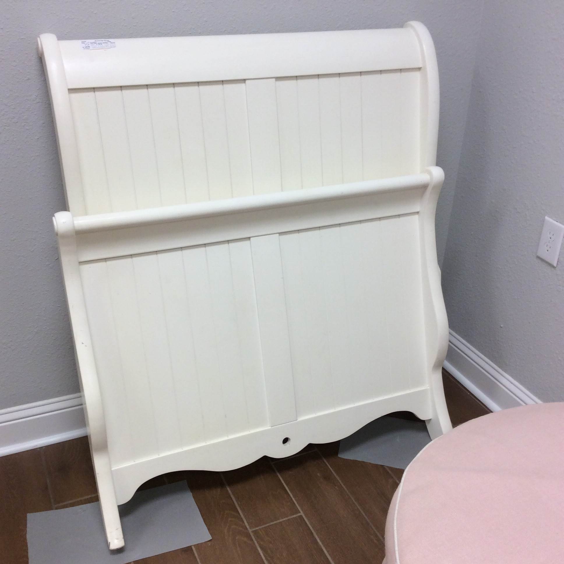 This twin-sized bed from Pottery Barn would be precious in a young girls room! It's a sleigh bed painted a creamy vanilla and comes with rails. Priced well too!