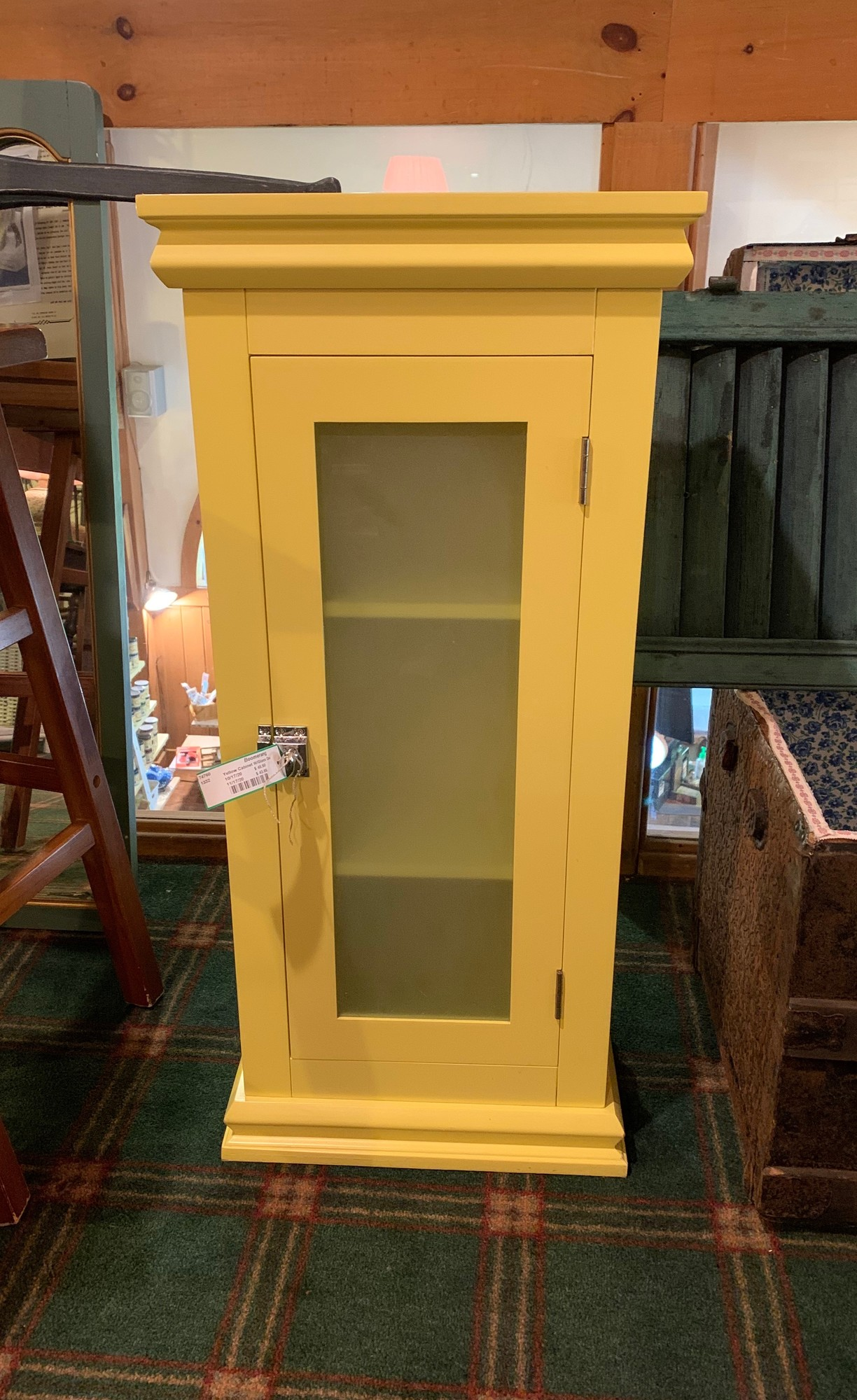 Yellow Cabinet with Glass Door<br />  Size: 15x8x33<br /> Great little cabinet to be used anywhere in your house.