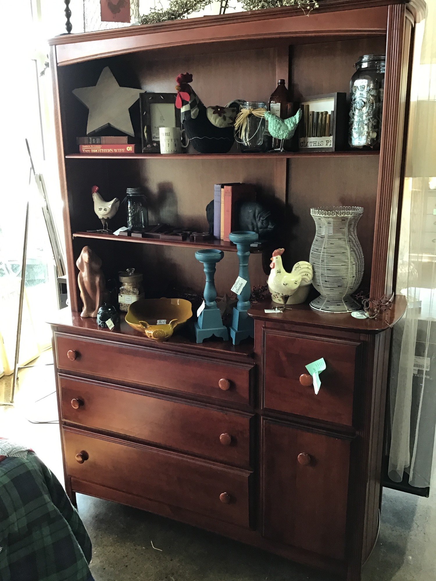 "This dresser has 4 large drawers and a lower cabinet for storage. There is also a removable hutch with shelving. There are some wear marks on the top of this dresser, but would make a great piece for a child's bedroom! We have a matching chest of drawers and a coordinating trundle bed as well.<br /> Dimensions are 54"" x 17-1/2"" x 75"""