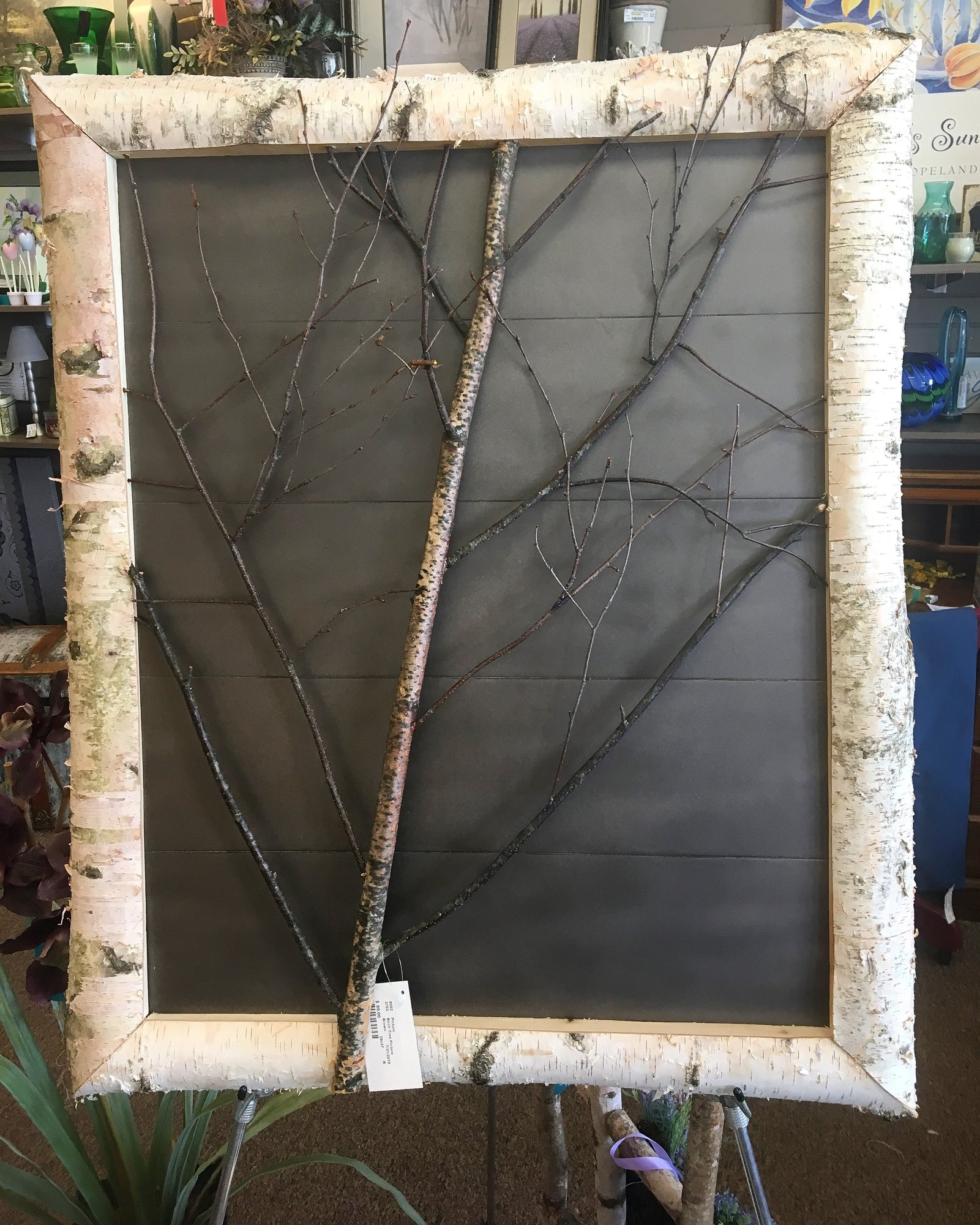 This piece was crafted by a local woodworker and artist. The natural birch wood is harvested locally and makes a beautiful accent piece for any space.