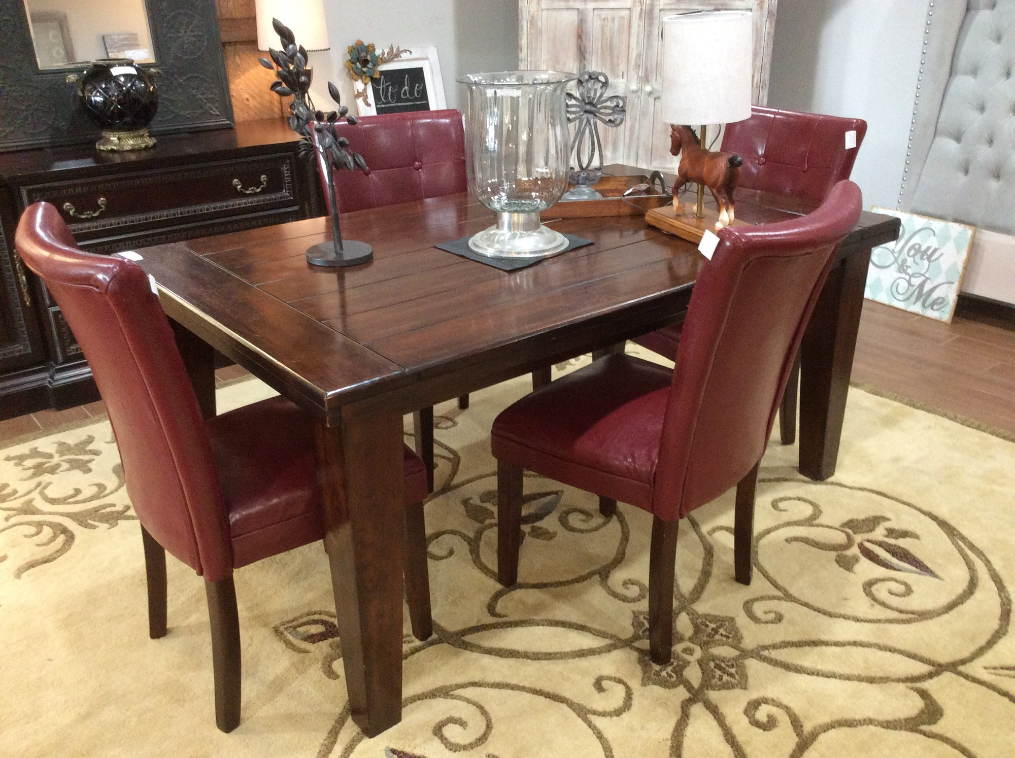 BARGAIN ALERT!!!!! This handsome dining set could be yours today for ONLY $345!!! The table appears to be solid wood and has a few surface issues, but no major damage. The 4 chairs are from Kirklands, and features maroon pleather upholstery and button tufted backs. Hurry though, this won't last here for long!