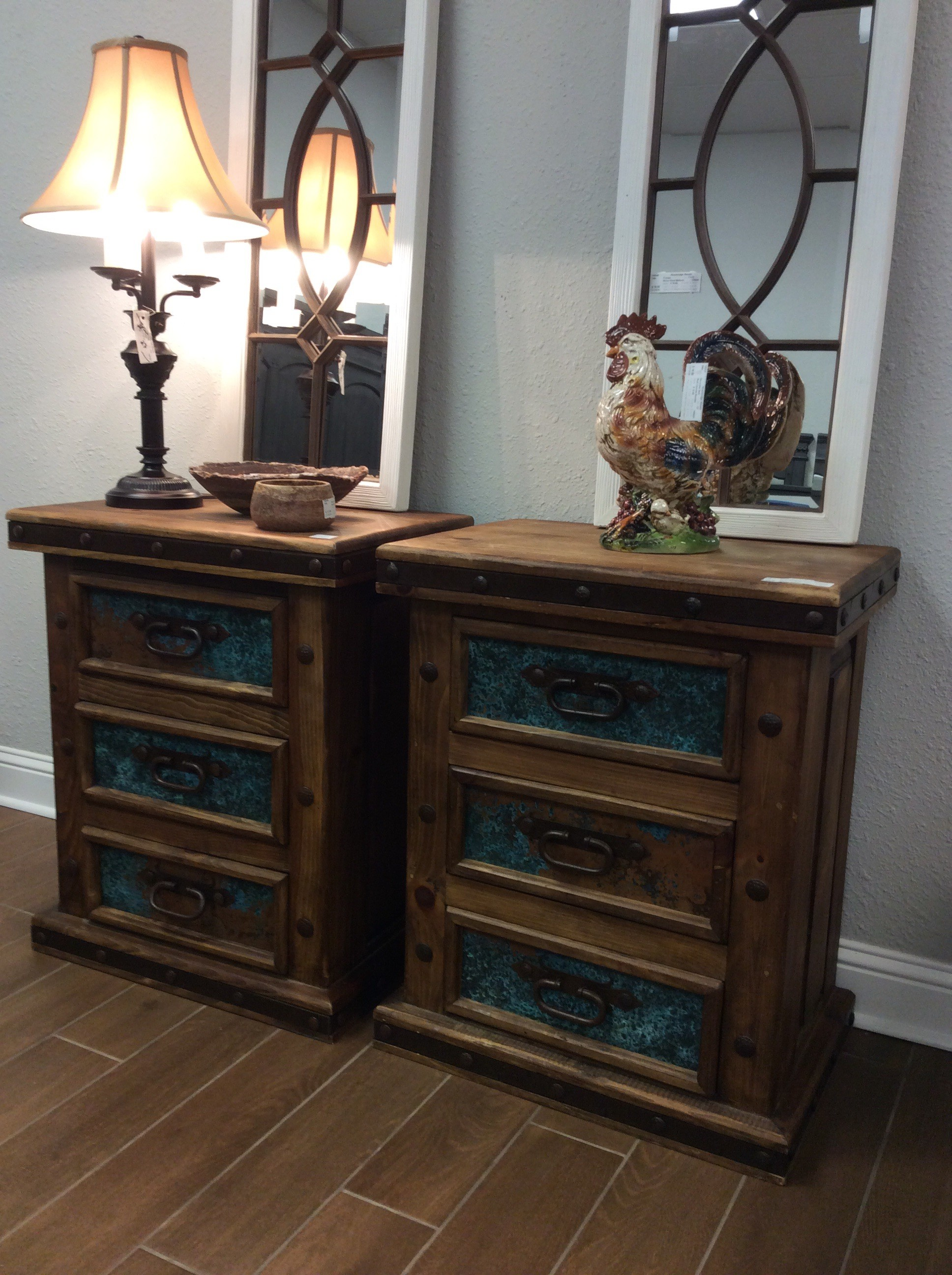 Rustic all the way but with a pop of brilliant color! Constructed of re-claimed pine with a heavy metal trim and a big, bold nailhead stud - they are hearty and well made. The drawers have a splash of vibrant turquoise that draws the eye and adds character.