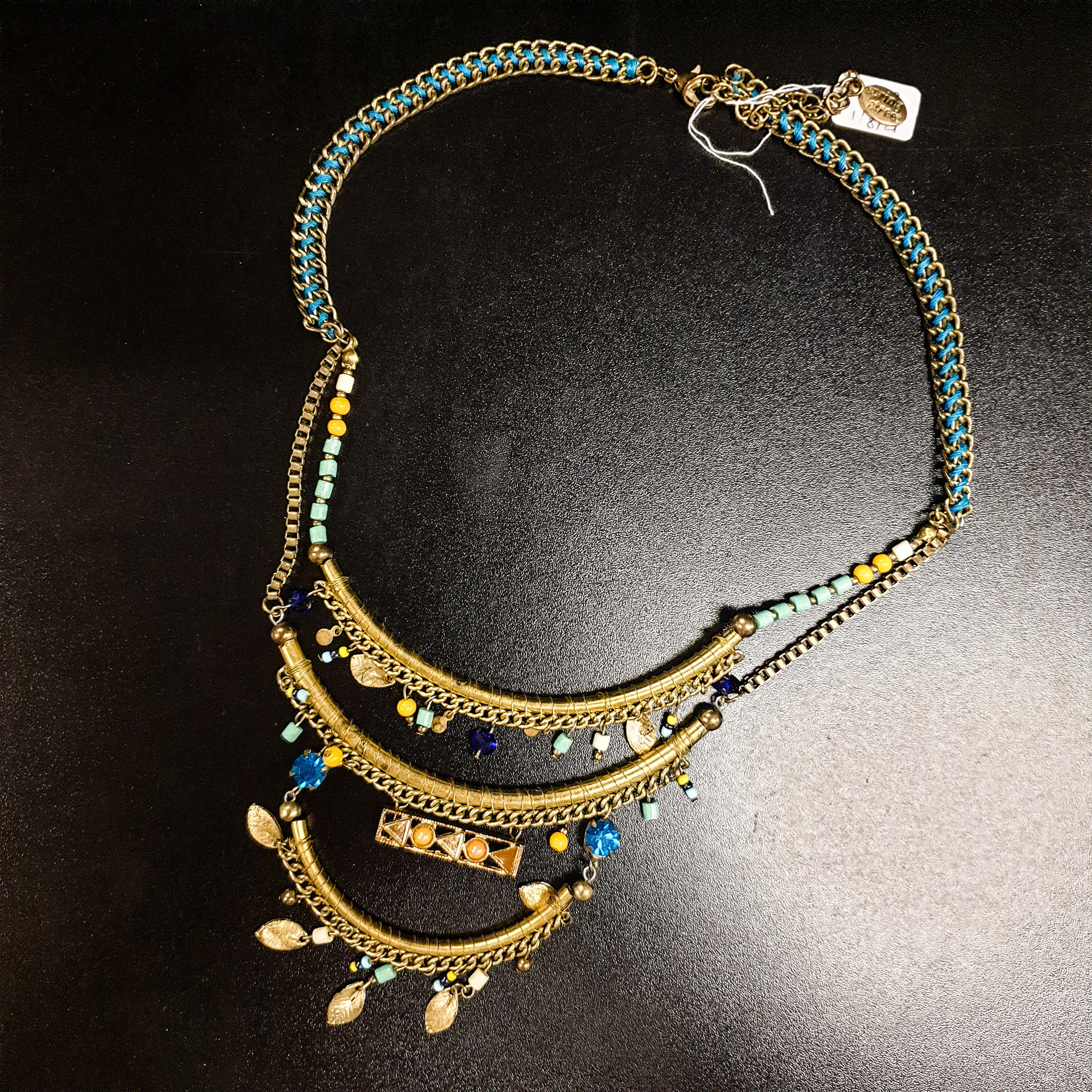 Beautiful Spring Street Necklace.<br /> - Gold and teal color<br /> - Multicolor beads and charms<br /> - Adjustable closure<br /> - Necklace length: 12.5 in.<br /> <br /> * Please note that these measurements and pictures are for reference only and may vary slightly from the original.